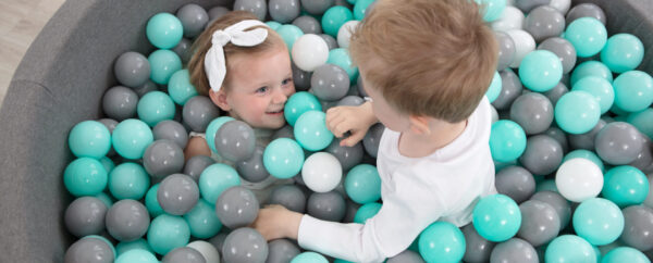Kids playing in a dry ball pool